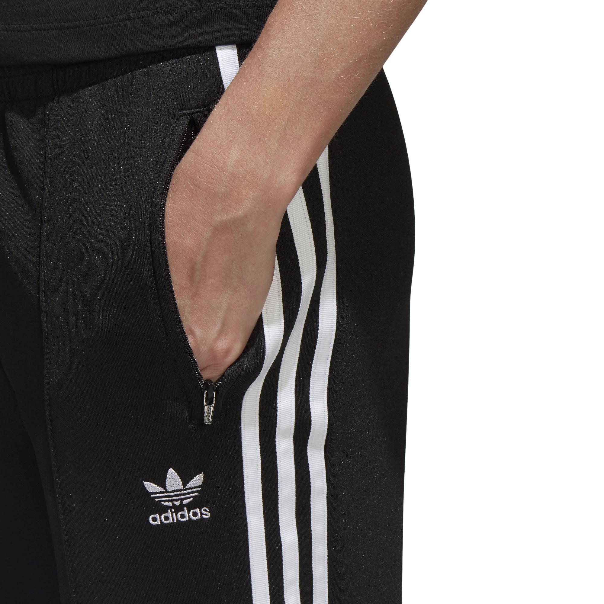 najwyższa jakość oficjalny sklep nowy przyjeżdża spodnie adidas SST CE2400